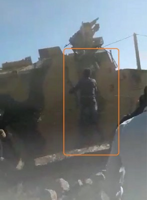 a_bare_handed_civilian_protester_tries_to_get_on_a_turkish_military_vehicle_as_if_he_wanted_to_speak_at_the_drivers_window_who_accelerates_and_drives_off_obs._av__ef_scr.shot_400
