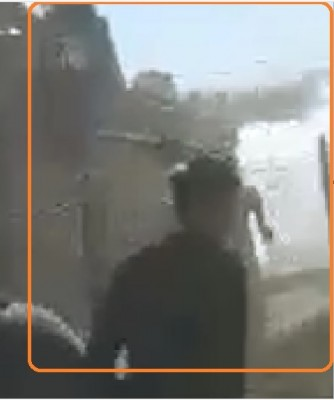 after_having_been_hit_the_protestor_falls_down_desperately_trying_to_hold_x_by_his_2_hands_as_a_shot_of_gas_is_fired_from_the_t._window__obs._video_ef_screenshot_400