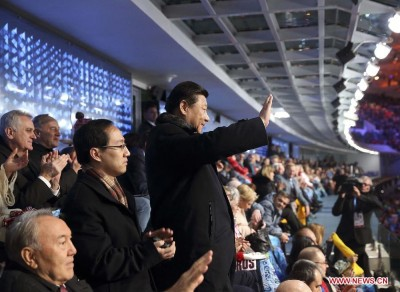 chinas_xi_ping_waves_to_the_national_chinese_delegation_tp_socho_olympic_games_400