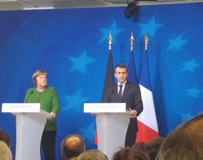 french_president_concludes_press_coinf._with_german_chancellor_merkel_by_looking_at_agg_eurofora_400