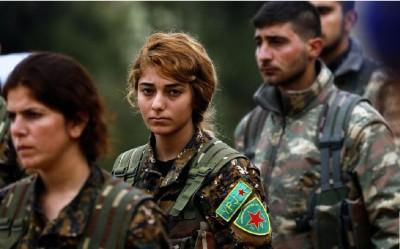 le_parisien__newspapers_photo__sad_syrian_kurdish_militants_at_a_funeral_in_quamisli_400