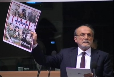 mep_kurcu_brandishes_times_frontpage_on_syrian_kurdish_womens_fight_against_isis_islamist_terror_eurofora_screenshot_400