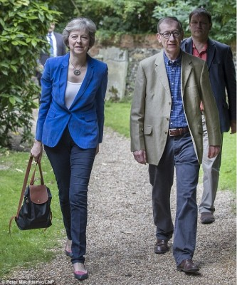 new_uk_pm_theresa_may_walking_to_church_on_sunday_with_her_husband_400
