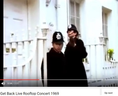 outgoing_labour_former_governments_policmen_knocking_at_beatles_door_during_controversial_get_back_song_at_famous_abbey_road_rooftop_concert_london_1969_400